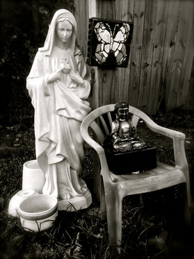 Madonna and Buddha, yard statuary